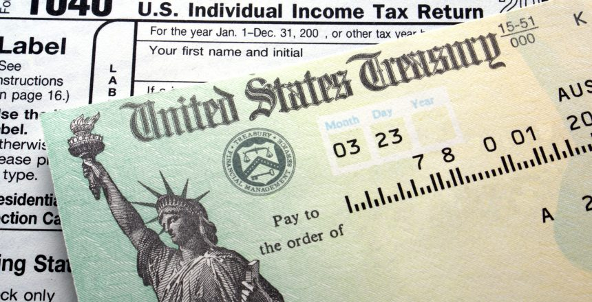 Tax return check on 1040 form background