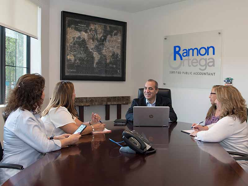 Ramon Ortega Meeting Clients